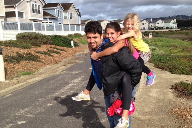 David Moore with his daughters