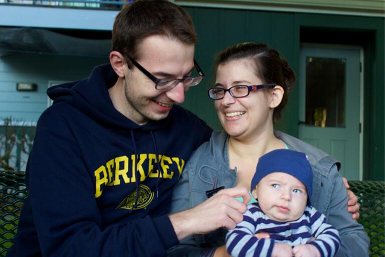 Michal Olszewski with his wife and son